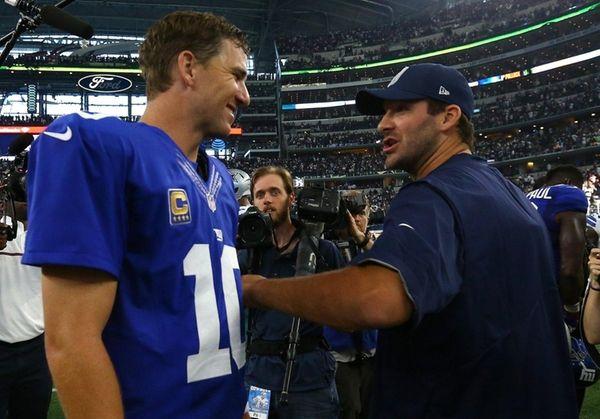 Injured Dallas Cowboys quarterback Tony Romo congratulates Eli