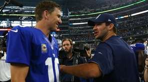 Injured Dallas Cowboys quarterback Tony Romo congratulates Eli