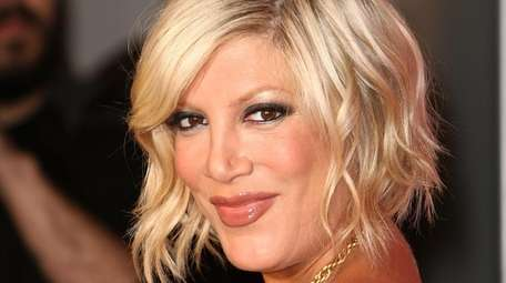 Actress Tori Spelling arrives at a cocktail party