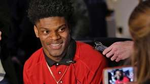 Louisville quarterback Lamar Jackson is interviewed during a