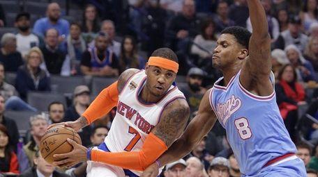 New York Knicks forward Carmelo Anthony, left, drives