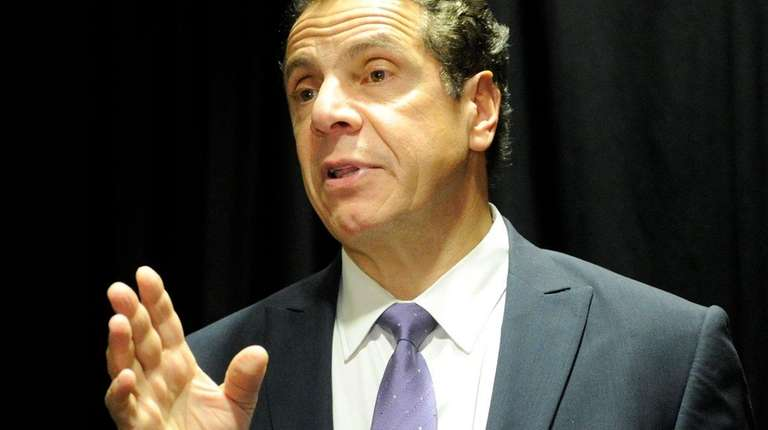 Gov. Andrew M. Cuomo speaks to reporters after