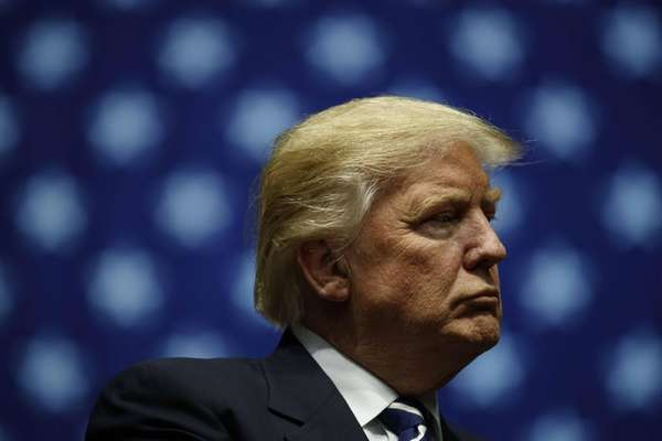 President-elect Donald Trump looks on during at the