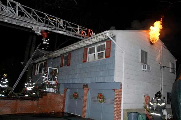 Multiple fire departments battle a house fire on