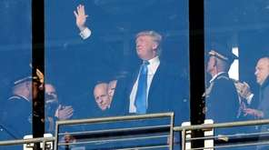 President-elect Donald Trump watches the game between the