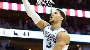 Villanova's Josh Hart goes up for a layup