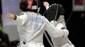 Silvie Binder of Westchester Fencing (facing) lunges for