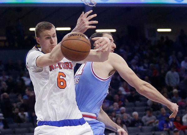 New York Knicks forward Kristaps Porzingis, left, goes