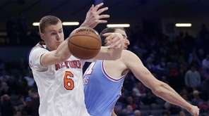 New York Knicks forward Kristaps Porzingis, left, goes