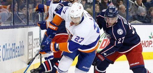 The Islanders' Anders Lee controls the puck against