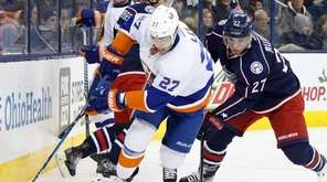 The Islanders' Anders Lee controls the puck against