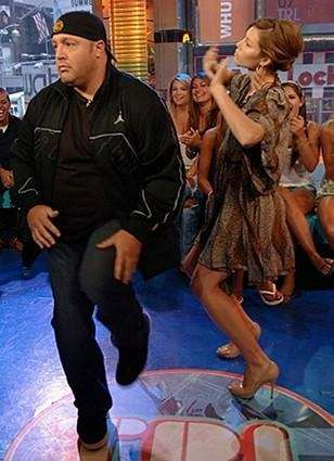 Kevin James and Jessica Biel enjoy a dance.