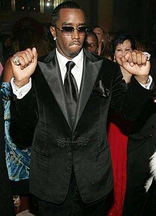 Sean Combs pumps his fists in the air.