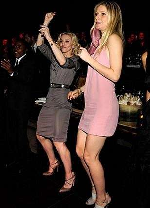 Madonna and Gwyneth Paltrow mid dance move.