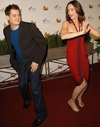 Michael Buble and Emily Blunt dancing.