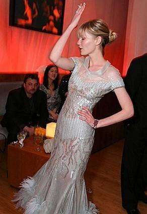 Kirsten Dunst poses while dancing.