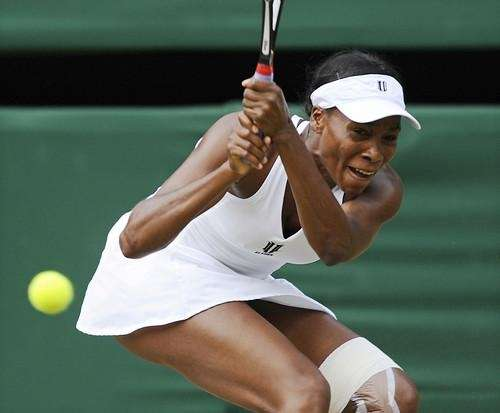 Venus Williams plays against her sister, Serena, during