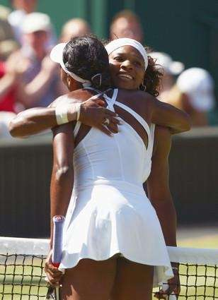 Serena Williams is congratulated by sister Venus Williams