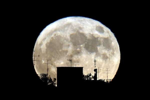 A Supermoon rises against the skyline in Madrid,