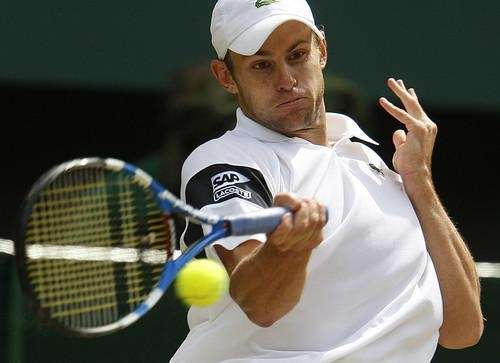 Andy Roddick returns to Roger Federer of Switzerland