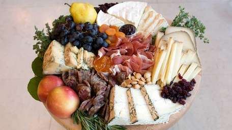 A cheese and charcuterie platter at Red Maple