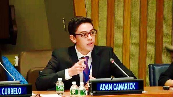 Adam Canarick, a Syosset High School senior, speaks
