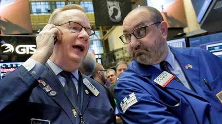 Trader Dennis Maguire, with specialist Peter Giacchi, right,