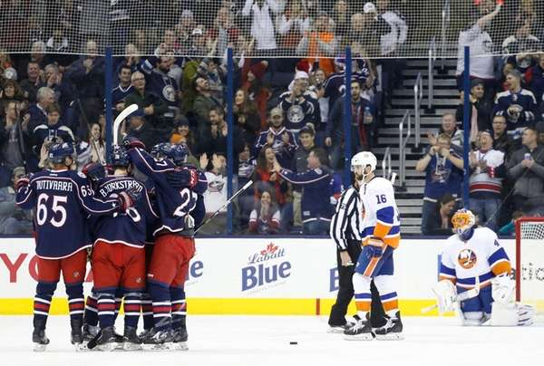 Columbus Blue Jackets players celebrate a goal against