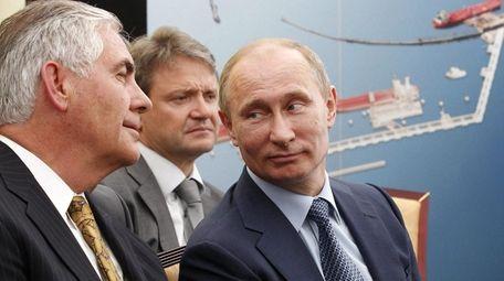 ExxonMobil Chairman and CEO Rex Tillerson, left, attends