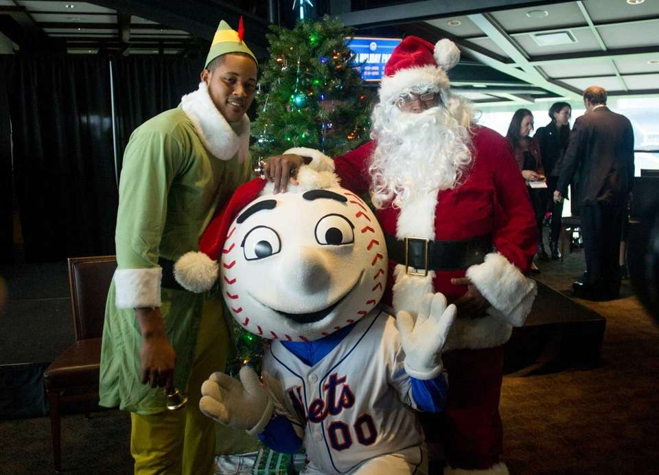 Jenrry Mejia played Santa Claus alongside his elf,