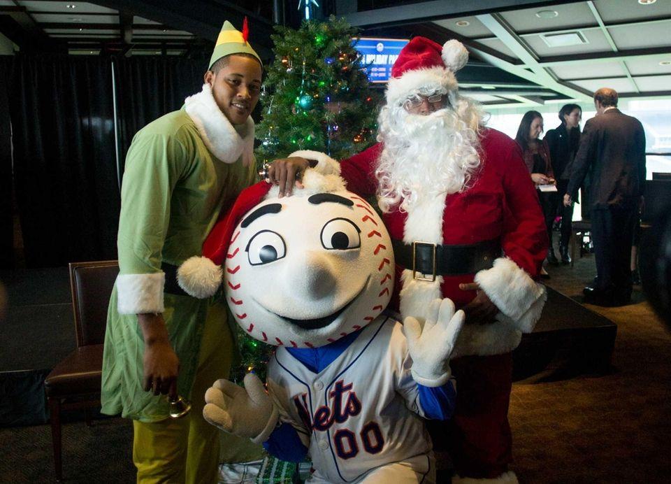 Jenrry Mejia played Santa Claus alongside his elf,