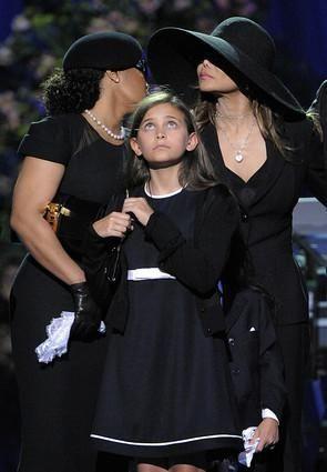 Janet Jackson, left, and sister LaToya Jackson, stand