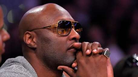 Lamar Odom attends an NBA game on March
