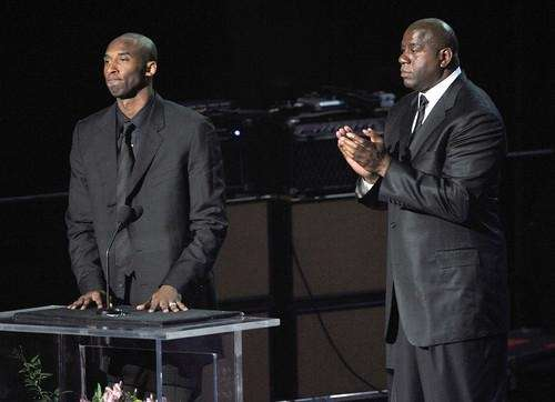 Basketball players Kobe Bryant (L) and Earvin