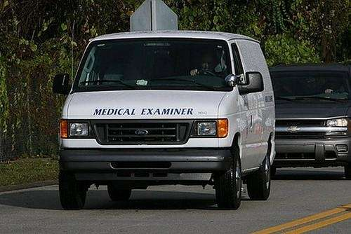 Orange County Medical Examiner leaves with the remains
