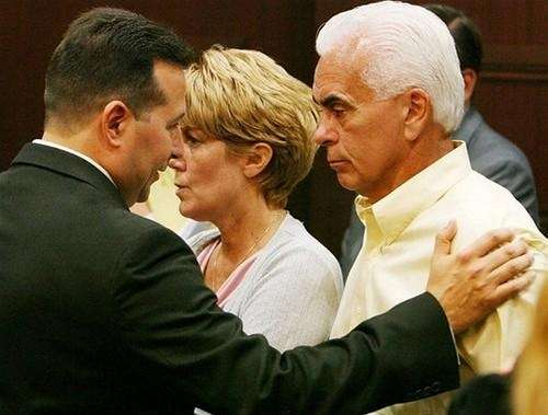 Attorney Jose Baez (left) consoles George (right) and