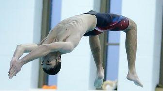 Smithtown's Michael Paolillo dives during the Suffolk boys