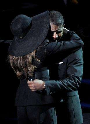 Singer Usher hugs LaToya Jackson at the Michael