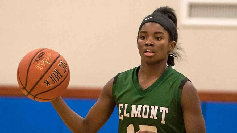 Elmont's Zhaneia Thybulle takes the ball up the