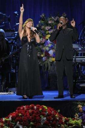 Singers Mariah Carey and Trey Lorenz perform during