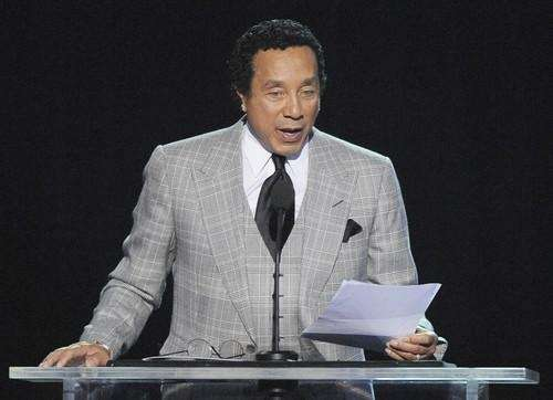 Musician Smokey Robinson speaks during the memorial service