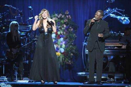Mariah Carey (L) sings with Trey Lorenz at