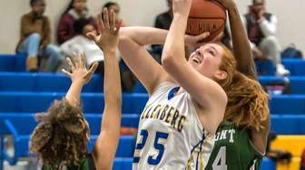 Kellenberg's Morgan Staab attempts a shot between Elmont's