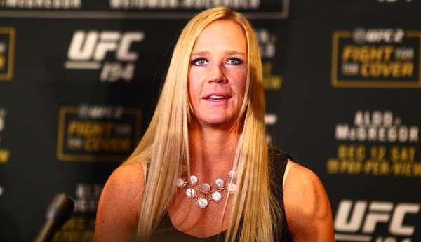 Holly Holm answers questions from the media during