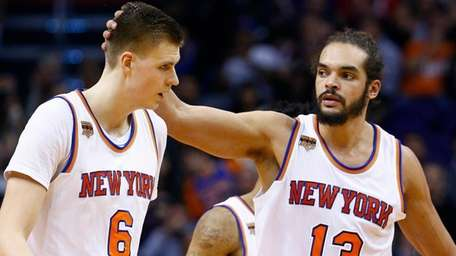 New York Knicks center Joakim Noah (13) pats