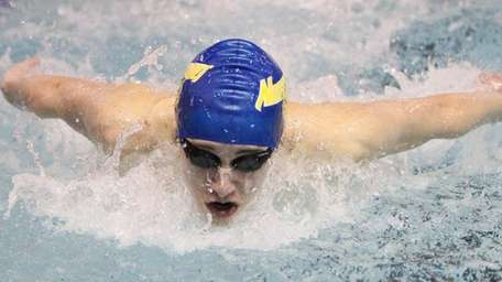 Northport's Zachary Papsco wins the 100 butterfly against