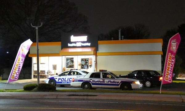 Suffolk County police respond to the scene after