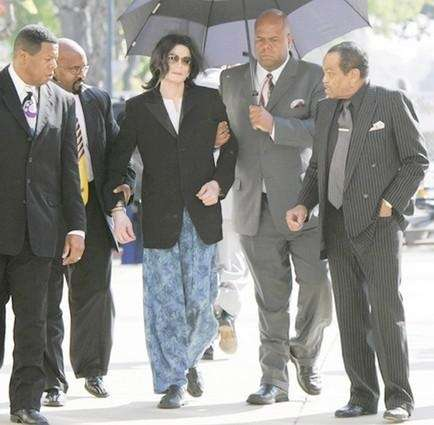 Michael Jackson and his father, Joe Jackson, right,