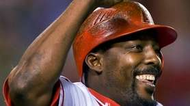 Vladimir Guerrero celebrates hitting his 400th career home