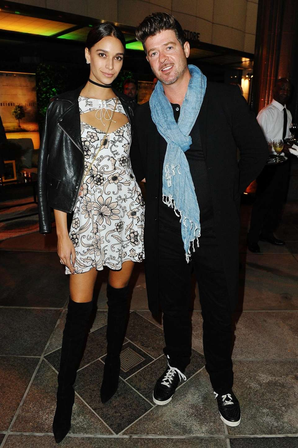 April Love Geary and Robin Thicke arrive at